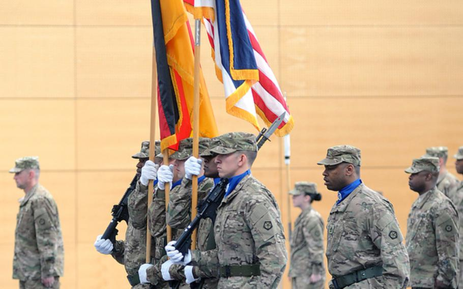The V Corps color guard brings up the unit's colors and the German and American flags at the casing of the colors ceremony at Wiesbaden Army Airfield, Germany, on Thursday.