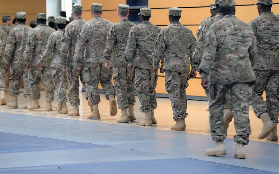 Soldiers of V Corps march out of the Wiesbaden Army Airfield fitness center following a casing of the colors ceremony for the corps on Thursday. The corps is headed for an Afghanistan deployment and is leaving Germany for good after more than 60 years.