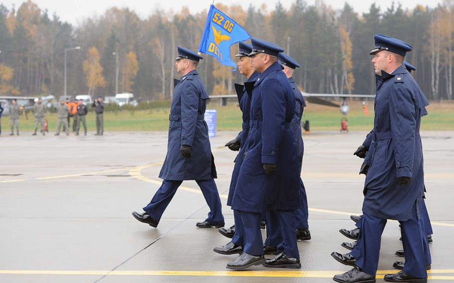 Airmen of Detachment 1, 52nd Operations Group march onto the flight line at the unit's activation ceremony in Lask, Poland, Friday.  Detachment 1 is the first U.S. military unit permanently stationed in Poland.