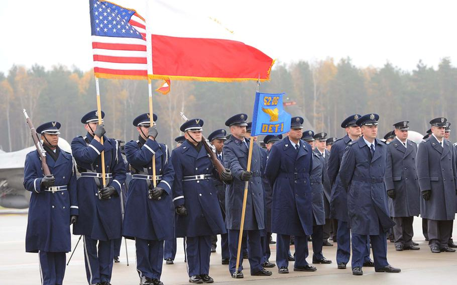 The Spangdahlem Air Base color guard and airmen of Detachment 1, 52nd Operations Group at the unit's activation ceremony in Lask, Poland, Friday. Detachment 1 is the first U.S. military unit permanently stationed in Poland.