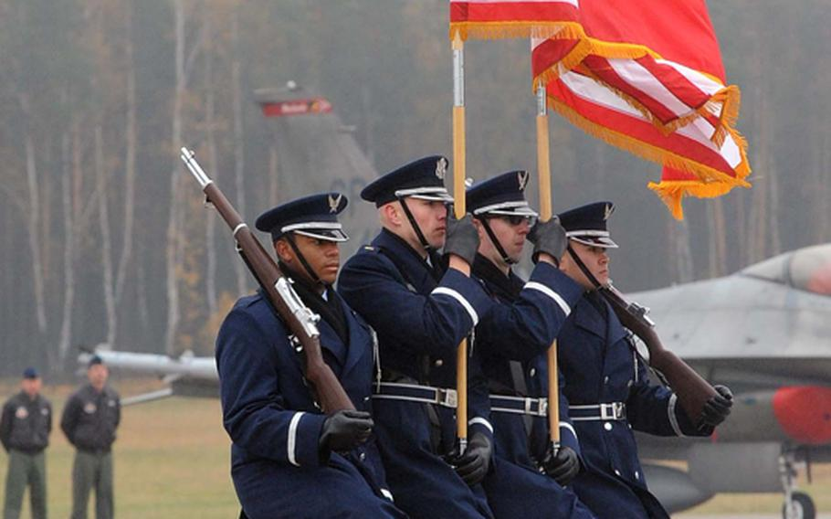 The Spangdahlem Air Base color guard marches off the field at the conclusion of the activation ceremony for Detachment 1, 52nd Operations Group in Lask, Poland, Friday.