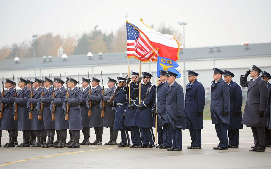 Polish military, the Spangdahlem Air Base color guard and airmen of Detachment 1, 52nd Operations Group at the unit's activation ceremony in Lask, Poland, Friday.   Detachment 1 is the first U.S. military unit permanently stationed in Poland.