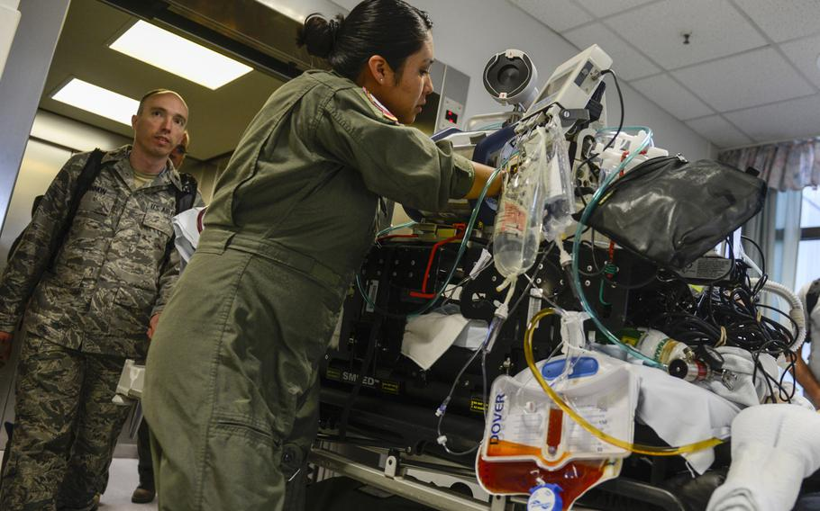Medical personnel with the Acute Lung Rescue Team begin transporting a patient on extracorporeal membrane oxygenation treatment from Landstuhl Regional Medical Center, Germany, to the San Antonio Military Medical Center, Texas. This was the first time the military moved an ECMO patient  such a distance.