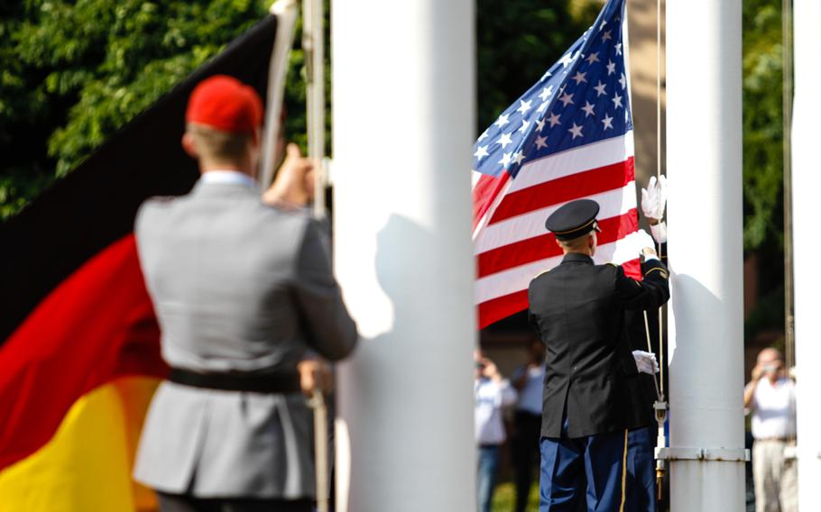 German and American color guards lower their country's flags one last time Friday at Campbell Barracks in Heidelberg. The garrison, once home for the U.S. Army Europe and a major NATO headquarters, held its final retreat ceremony Friday. The U.S. military will soon hand the property and other bases in the city back to German control.