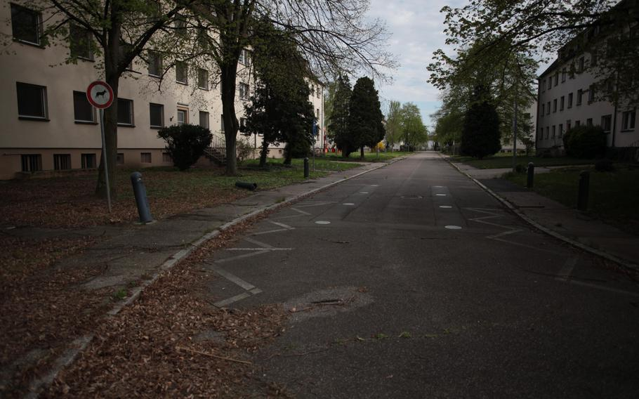 Leaves litter an empty street at the U.S. Army's Mark Twain Village in Heidelberg, Germany, where the Army held its final retreat ceremony Friday. After nearly seven decades, the Army is moving out of the city as part of an ongoing realignment of forces in Europe.