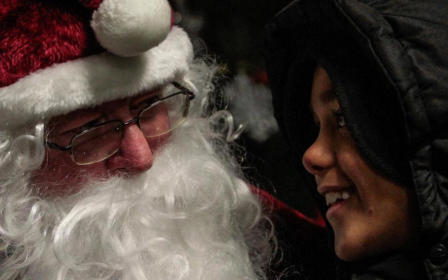 Justice Warren, 8, talks with Santa at the 21st Theater Sustainment Command's holiday tree lighting ceremony Wednesday, Dec. 4, 2013, at Panzer Kaserne in Kaiserslautern, Germany.