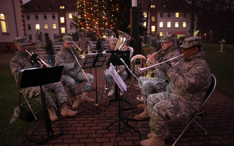 Soldiers of the U.S. Army Europe Brass Quintet play holiday songs at the 21st Theater Sustainment Command's tree lighting ceremony Wednesday, Dec. 4, 2013.