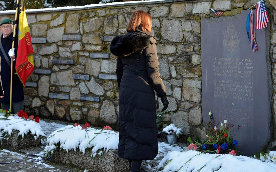 Denise Campbell Bauer, the U.S. ambassador to Belgium, pauses for a moment after laying a wreath at the Malmedy Massacre Memorial on the outskirts of Baugnez, Belgium, Sunday, Dec. 14, 2014. On Dec.17, 1944, Nazi SS troops murdered 84 American prisoners of war during the Battle of the Bulge. Baugnez is a suburb of Malmedy.
