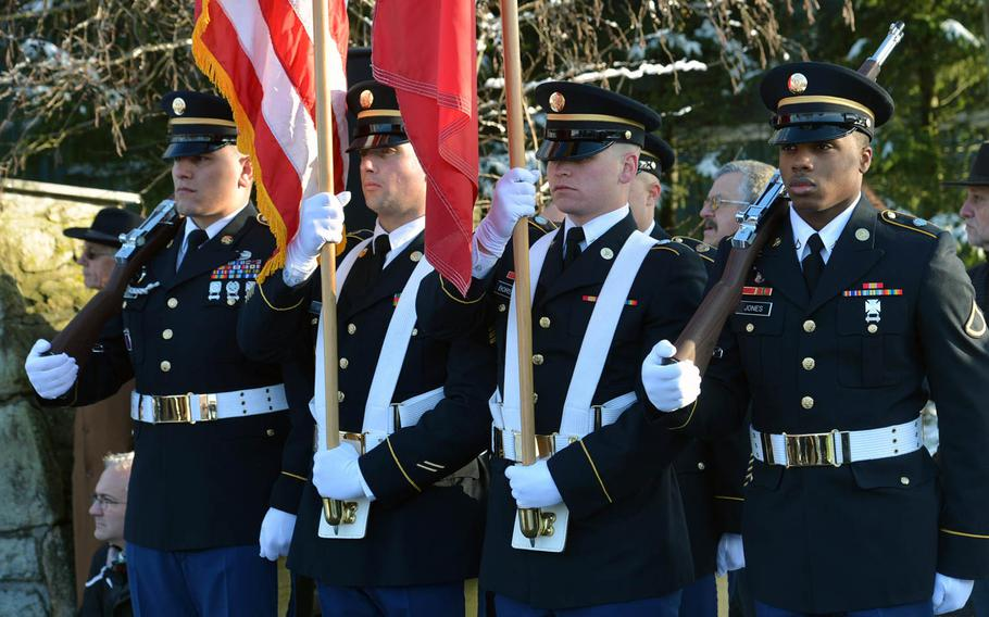 Members of an American honor guard made up of soldiers from USAG Benelux and SHAPE stand in formation at a ceremony marking the 70th anniversary of the Malady massacre, Sunday, Dec. 14, 2014. On Dec.17, 1944, Nazi SS troops massacred 84 American prisoners of war during the Battle of the Bulge. Baugnez is a suburb of Malmedy.