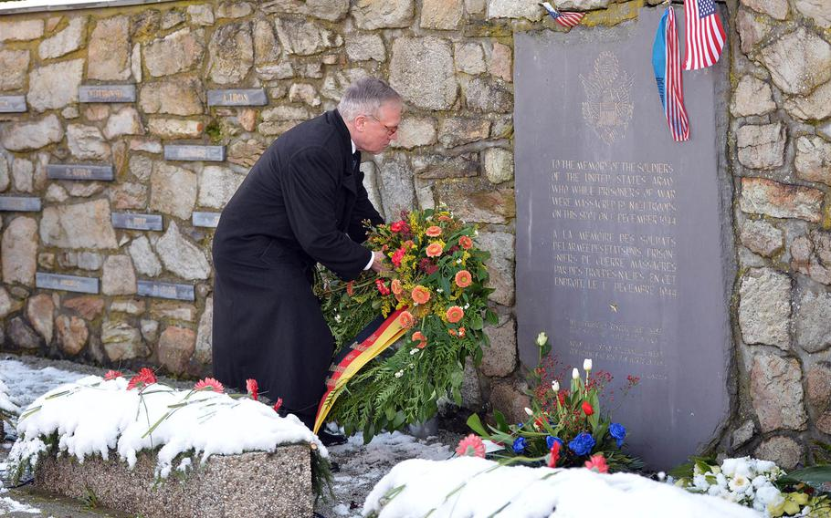 The German ambassador to Belgium, Eckart Cuntz, lays a wreath at the Malady Massacre Memorial at a ceremony marking the 70th anniversary of the Malady massacre, Sunday, Dec. 14, 2014. On Dec.17, 1944, Nazi SS troops murdered 84 American prisoners of war during the Battle of the Bulge. Baugnez is a suburb of Malmedy.