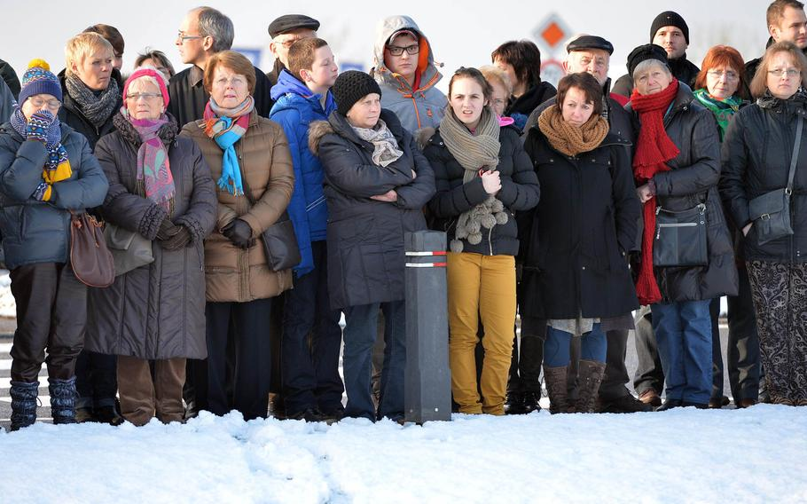 A crowd watches the  ceremony marking the 70th anniversary of the Malady massacre Sunday, Dec. 14, 2014. On Dec.17, 1944, in Baugnez, Belgium. Nazi SS troops killed 84 American prisoners of war during the Battle of the Bulge. Baugnez is a suburb of Malmedy.
