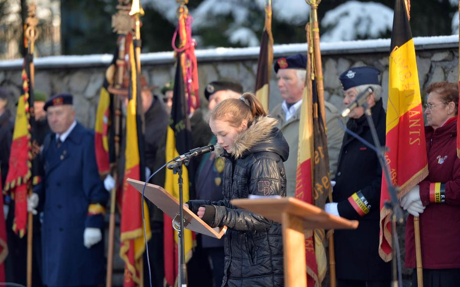 Victoria Weidisch reads the names of the 84 American prisoners of war who were  massacred by the Germans on Dec. 17, 1944, during the Battle of the Bulge. A ceremony marking the 70th anniversary of the Malmady massacre was held Sunday, Dec. 14, 2014, in  Baugnez, a suburb of Malmedy.