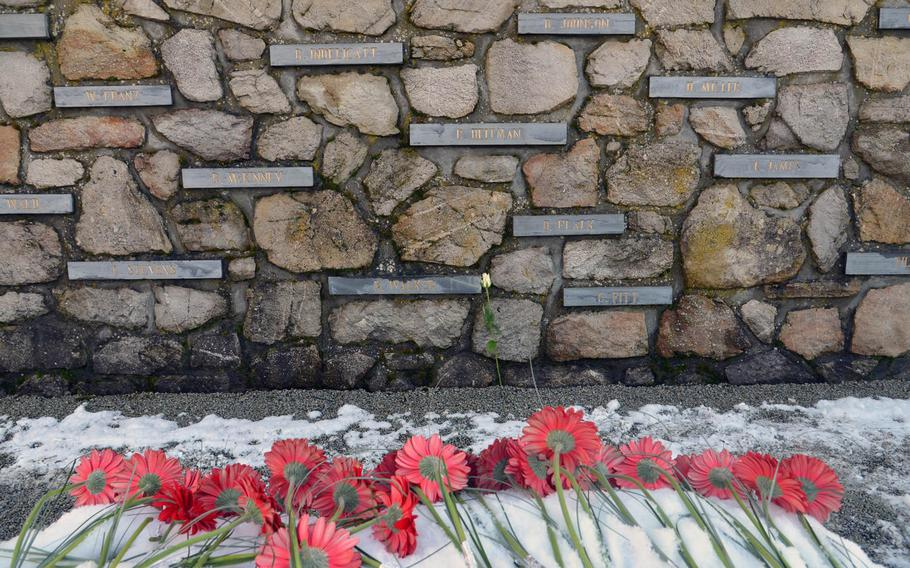 Flowers left by school children lie in front of the Malady Massacre Memorial following a ceremony marking the 70th anniversary of the Malady massacre Sunday, Dec. 14, 2014. On Dec.17, 1944, in Baugnez, Belgium, Nazi SS troops killed 84 American prisoners of war during the Battle of the Bulge. Baugnez is a suburb of Malmedy.