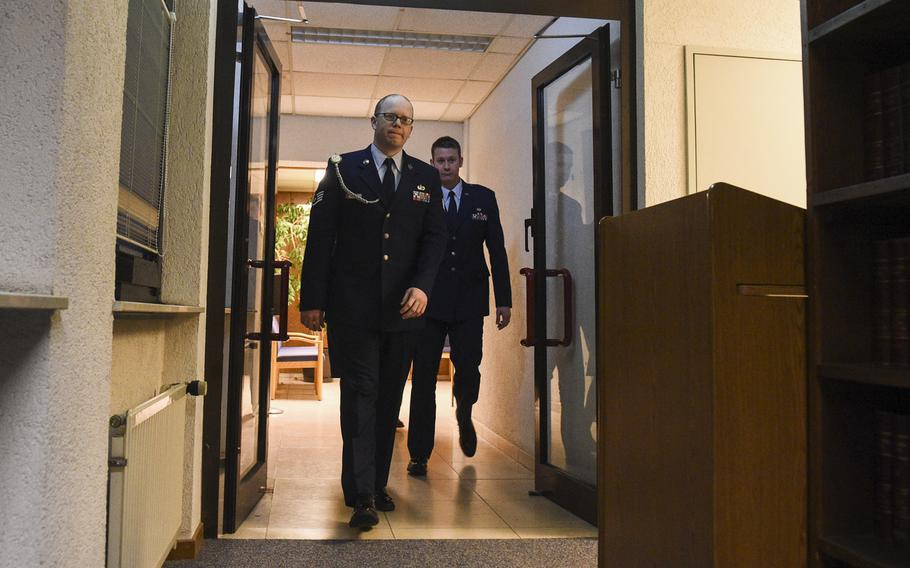 Air Force Staff Sgt. Sean Oliver walks into the courtroom, Thursday, Jan. 29, 2015, where he was found guilty a day earlier of unpremeditated murder in the killing of Navy Petty Officer 2nd Class Dmitry Chepusov, an American Forces Network broadcaster.