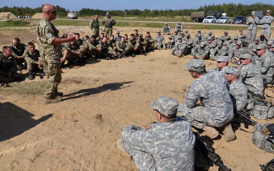 Soldiers of the173rd Airborne Brigade and Ukrainian army cadets train together at Exercise Rapid Trident near Yavoriv, Ukraine, Wednesday, Sept. 17, 2014. Paratroopers with the 173rd are on standby, awaiting approval to move forward with a long-planned training mission in Ukraine that is currently on hold.