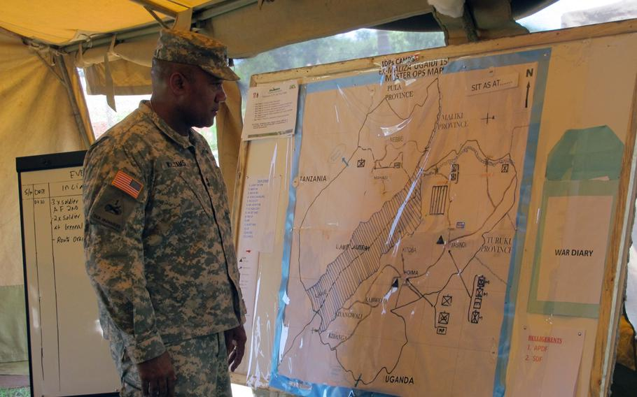 Maj. Gen. Darryl Williams, commander of U.S. Army Africa, looks at a map showing the location of troops involved in the Eastern Accord military exercise, which responded to a fictional east African country that descends into armed conflict among a number of groups and a humanitarian disaster after a political crisis.