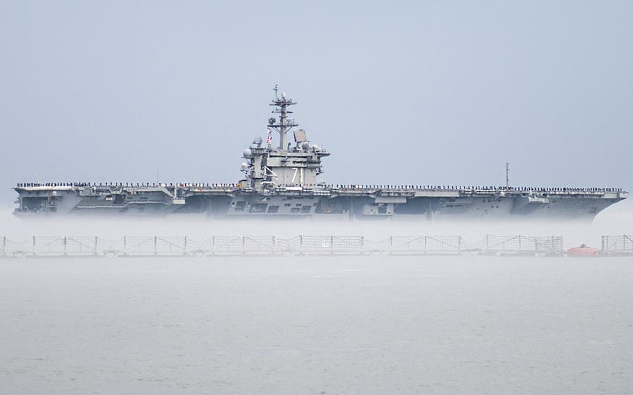 The aircraft carrier USS Theodore Roosevelt leaves Naval Station Norfolk for a scheduled deployment, March 11, 2015. The deployment is part of a regular rotation of forces to the 5th and 6th Fleet areas of operation.