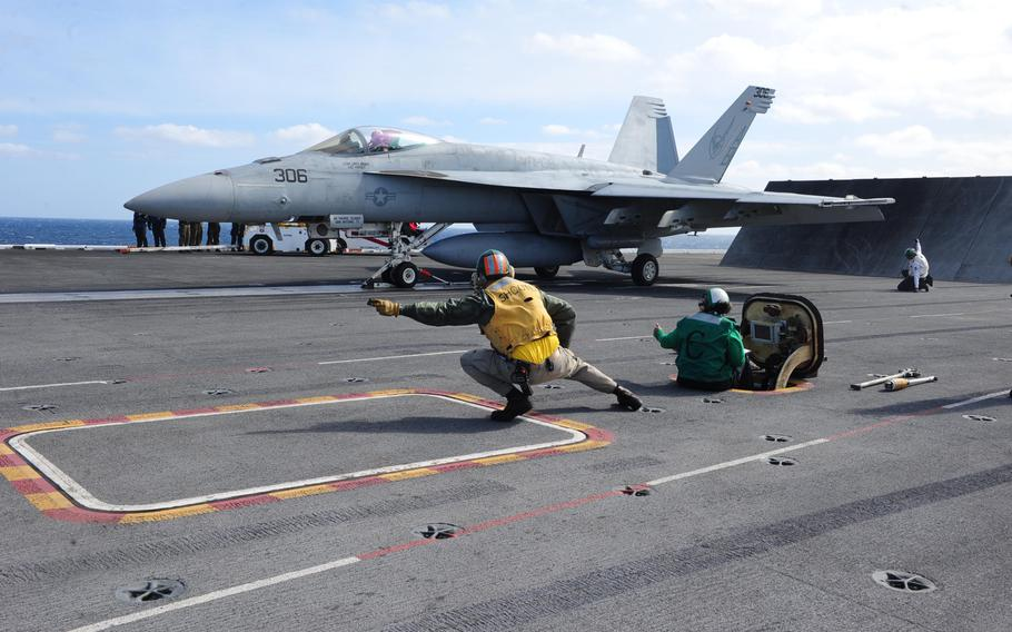 An F/A-18F Super Hornet assigned to the Knighthawks of Strike Fighter Attack Squadron (VFA) 136 prepares to launch from the flight deck of the USS Theodore Roosevelt, March 12, 2015. Theodore Roosevelt is deployed to conduct operations in the U.S.5th, 6th and 7th Fleet areas of responsibility.
