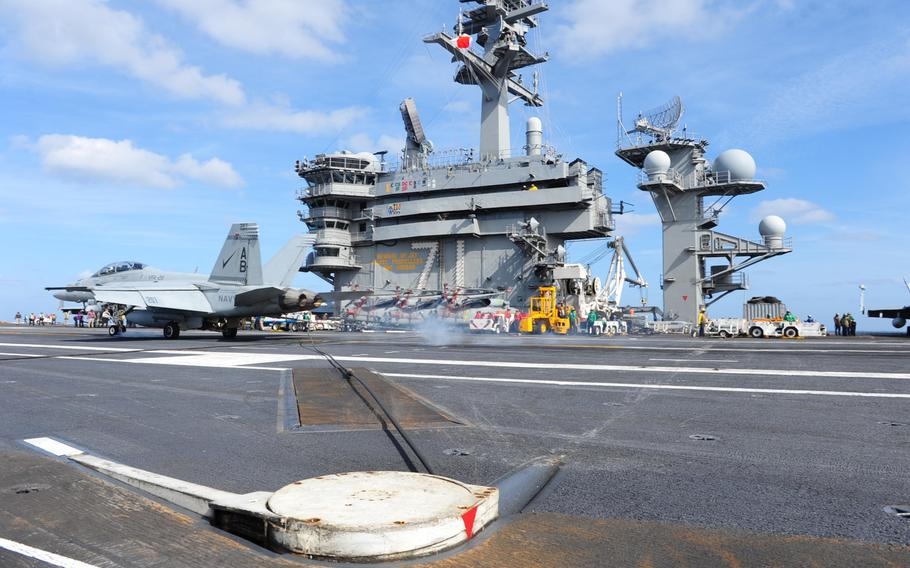 An F/A-18F Super Hornet assigned to the Checkmates of Strike Fighter Attack Squadron (VFA) 211 makes an arrested recovery on the flight deck of the Nimitz-class aircraft carrier USS Theodore Roosevelt March 12, 2015. Theodore Roosevelt will conduct operations in the U.S. Navy's 5th, 6th, and 7th Fleet areas of responsibility.