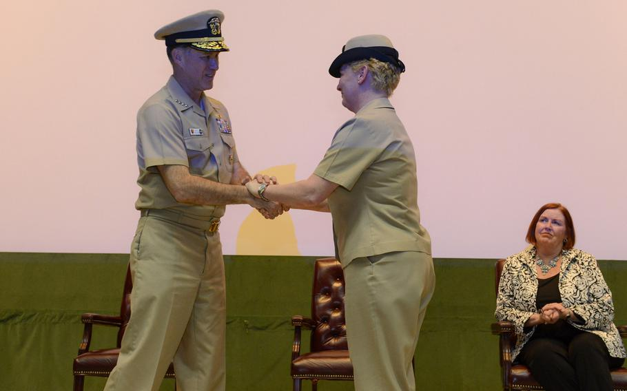 Commander of U.S. Naval Forces Europe-Africa Adm. Mark Ferguson congratulates Fleet Master Chief JoAnn Ortloff during her retirement ceremony on Friday, March 20, 2015. Ortloff, who joined the Navy in 1982, was the most senior enlisted active-duty female in the Navy at the time of her retirement.