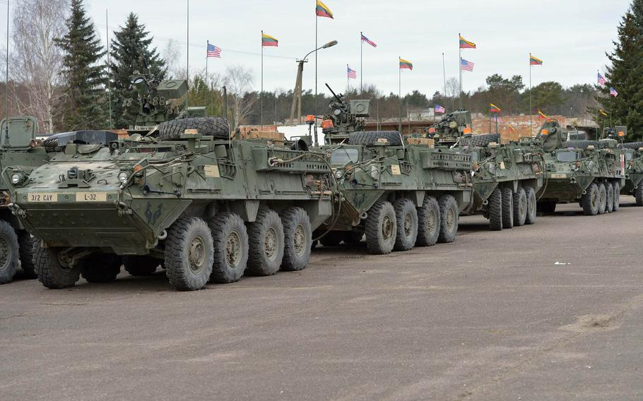 American and Lithuanian flags fly over Strykers of Lightning Troop, 3rd Squadron, 2nd Cavalry Regiment in Alytus, Lithuania, Monday, March 23, 2015.