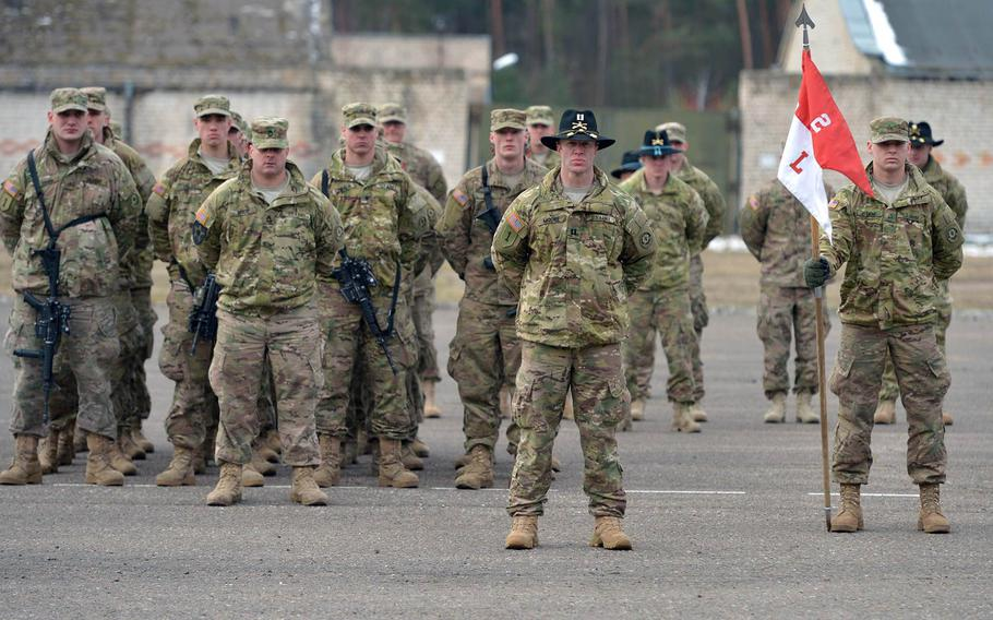 Soldiers of Lightning Troop, 3rd Squadron, 2nd Cavalry Regiment, under Capt. Russell Moore, center, listen to speeches during a farewell ceremony in Alytus, Lithuania, Monday, March 23, 2015. The Strykers of Lightning Troop,  and their supporting units began their Dragoon Ride convoy home to Vilseck, Germany, through Lithuania, Poland and the Czech Republic, following training in Lithuania.
