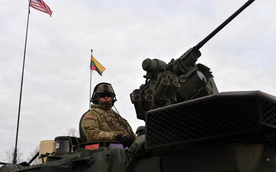 Spc. Bogdan Tkachuk of Lightning Troop, 3rd Squadron, 2nd Calvary Regiment sitting in his Stryker in Alytus, Lithuania, Monday, March 23, 2015, before his unit began their convoy back to Germany trough Lithuania, Poland and the Czech Republic as part of an operation dubbed Dragoon Ride. The unit had been training in Lithuania.