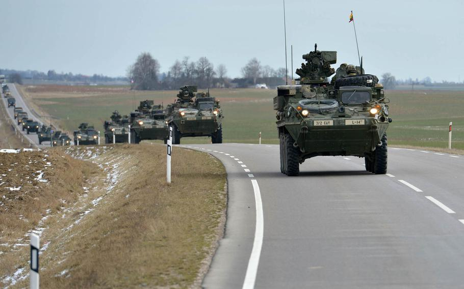 Strykers of Lightning Troop, 3rd Squadron, 2nd Cavalry Regiment convoy from Alytus, Lithuania, to the Polish border, Monday, March 23, 2015. They will continue their so-called Dragoon Ride through Poland and the Czech Republic to their home base at Vilseck, Germany, following training in Lithuania.