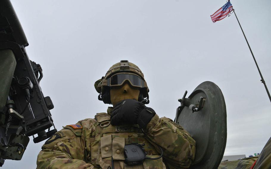 Sgt. Gregory Loomis of Iron Troop, 3rd Squadron, 2nd Cavalry Regiment talks on the radio during a stop on the outskirts of Panevezys, Lithuania, Monday, March 23, 2015. The soldiers of Iron Troop were convoying back to their home base in Vilseck, Germany, as part of the so-called Dragoon Ride, after training in Estonia.