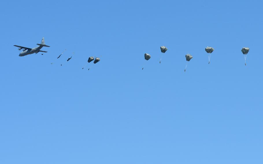 Soldiers from the Vicenza, Italy-based 173rd Airborne Brigade jump out of a U.S. Air Force C-130 into the Smardan training center, Romania, on Tuesday, March 24, 2015.
