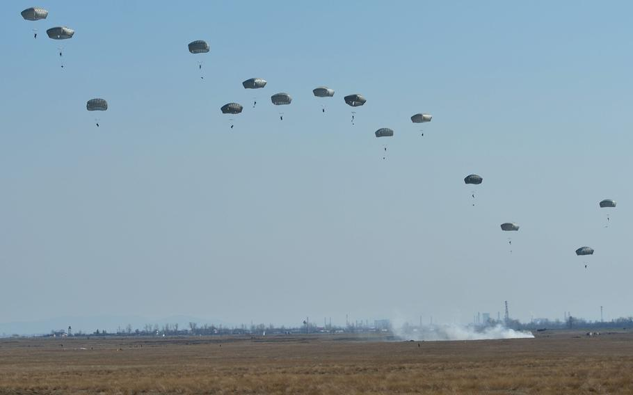 Soldiers from the Vicenza, Italy-based 173rd Airborne Brigade float into the Smardan training center, Romania, on Tuesday, March 24, 2015, as part of Operation Atlantic Resolve.