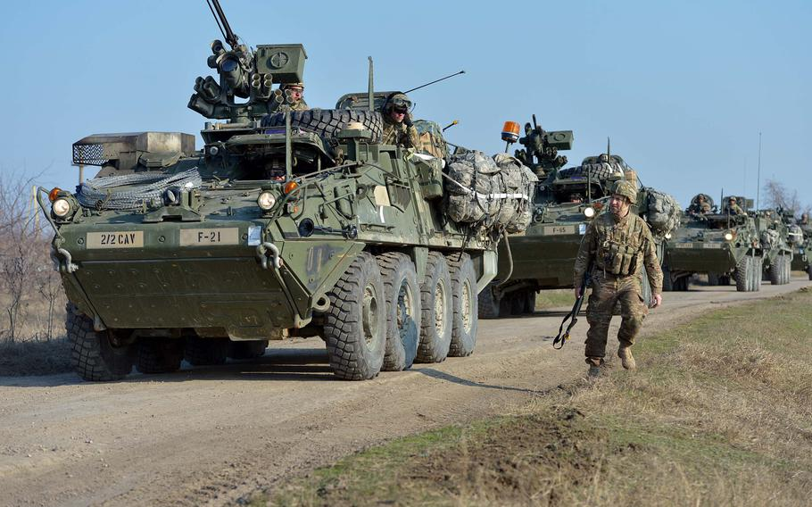 Strykers from 2nd Squadron, 2nd Cavalry Regiment roll into the Smardan training area in Romania to meet up with soldiers from the 173rd Airborne Brigade who parachuted in earlier as part of Operation Atlantic Resolve, onTuesday, March 24, 2015.