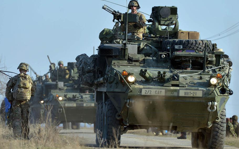 Strikers from 2nd Squadron, 2nd Cavalry roll into the Smardan training area in Romania to meet up with soldiers from the 173rd Airborne Brigade who parachuted in earlier as part of Operation Atlantic Resolve, Tuesday, March 24, 2015.