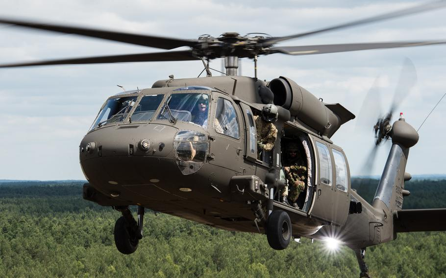 American and Czech soldiers prepare to land to airlift and transport a simulated prisoner of war during an air assualt raid at the Zagan Military Training Area, Poland, during NATO Exercise Noble Jump on June 16, 2015. The alliance has voted to give its military commander the power to call on the spearhead force at a moment's notice, but actual deployment still requires the approval of the National Security Council.