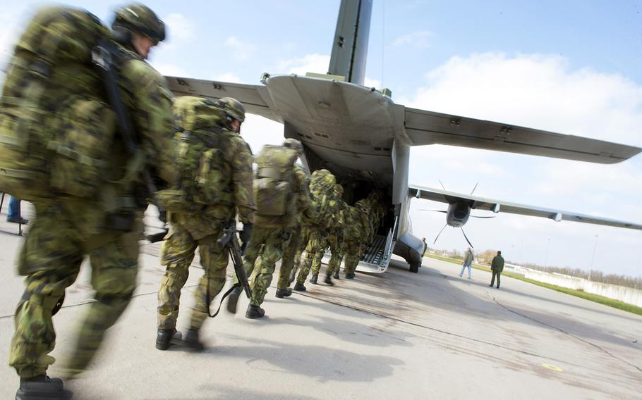 """Czech Soldiers from the 43rd Airborne Battalion, 2nd Company load onto a CASA C-295 aircraft during Exercise Noble Jump at the Pardubice Airfield, Czech Republic, on April 9, 2015. Exercise Noble Jump marks the first time that high-readiness units have physically tested their response to rapid """"orders to move"""" under the new VJTF framework."""