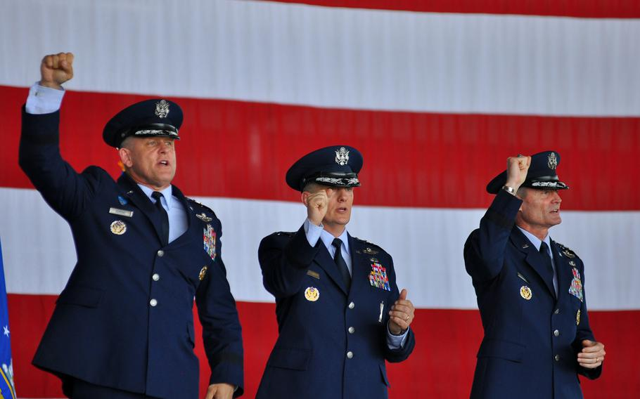 Gen. Frank Gorenc, Lt. Gen. Timothy M. Ray and Lt. Gen. Darryl L. Roberson pump their fists while singing the Air Force song at the end of a change of command for 3rd Air Force on Thursday, July 2, 2015, at Ramstein Air Base in Germany. Gorenc, left, commander of U.S. Air Forces in Europe and Africa, presided over the ceremony, in which Ray, center, assumed command of 3rd Air Force from the outgoing Roberson.