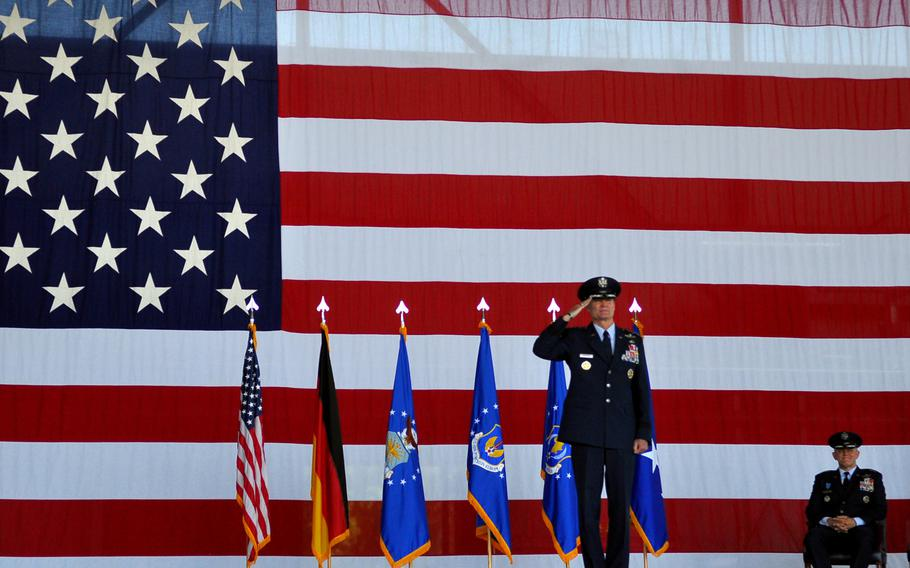 Lt. Gen. Darryl L. Roberson returns a final salute before officially handing over command of 3rd Air Force to his successor, Lt. Gen. Timothy M. Ray, during a change of command ceremony Thursday, July 2, 2015, at Ramstein Air Base in Germany.