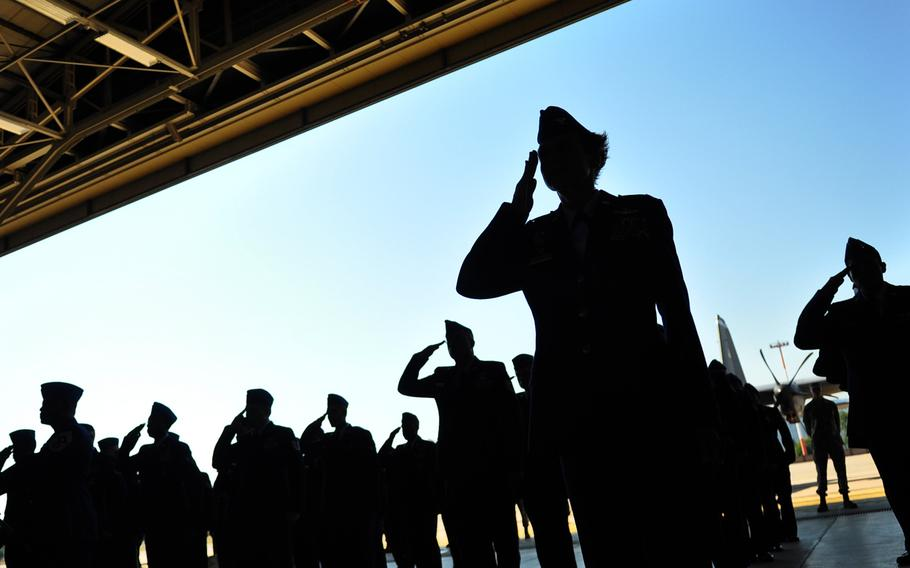 Airmen of 3rd Air Force render a first salute to their new commander Thursday, July 2, 2015, during a change of command ceremony at Ramstein Air Base.