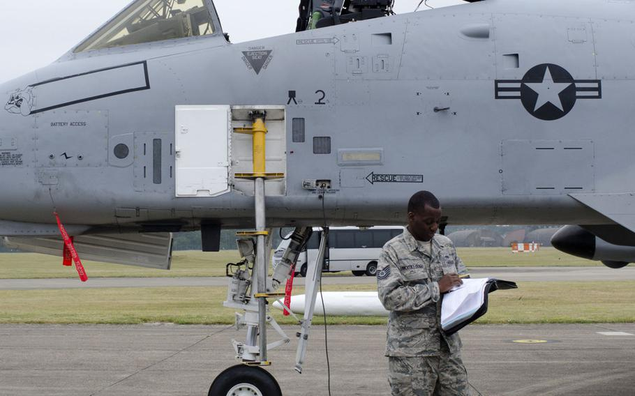 A U.S. airmAn prepares an A-10 Thunderbolt II for takeoff at RAF Lakenheath, England, on Wednesday, July 16, 2015. The U.S. deployed 12 A-10s to Europe earlier this year, and the planes have stopped at various bases throughout the Continent.