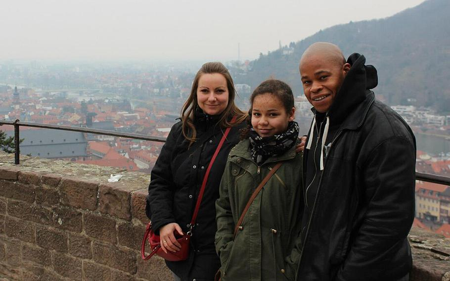 Amber Walker, then 10, stands between her parents, Claudia and Edmond, a U.S. Army staff sergeant, at Heidelberg Castle in Heidelberg, Germany, in 2013. Amber was killed on a ride at Holiday Park in Hassloch, Germany, in August 2014. German prosecutors announced this week that three park employees have been charged with negligent homicide in connection with Amber's death. Claudia Walker wants the park placed off-limits to U.S. military personnel in Europe.