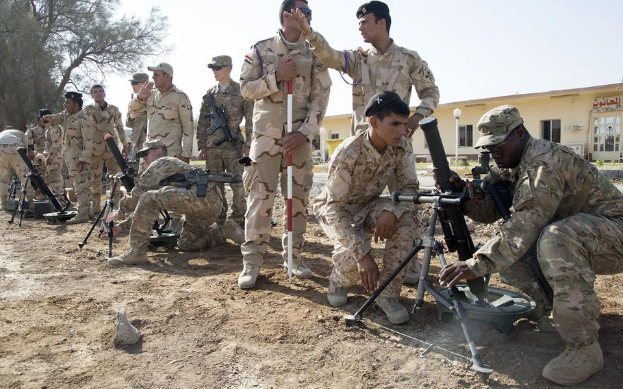 U.S. Soldiers assigned to Alpha Troop, 5th Squadron, 73rd Cavalry Regiment, 3rd Brigade Combat Team, 82nd Airborne Division, assist Iraqi soldiers assigned to the 73rd Brigade, 16th Division, with M224 60 mm mortar systems at Camp Taji, Iraq, June 25, 2015. On Friday, NATO announced it would join efforts to train Iraqi security forces, but the NATO mission will take place in Turkey and Jordan rather than inside Iraq.