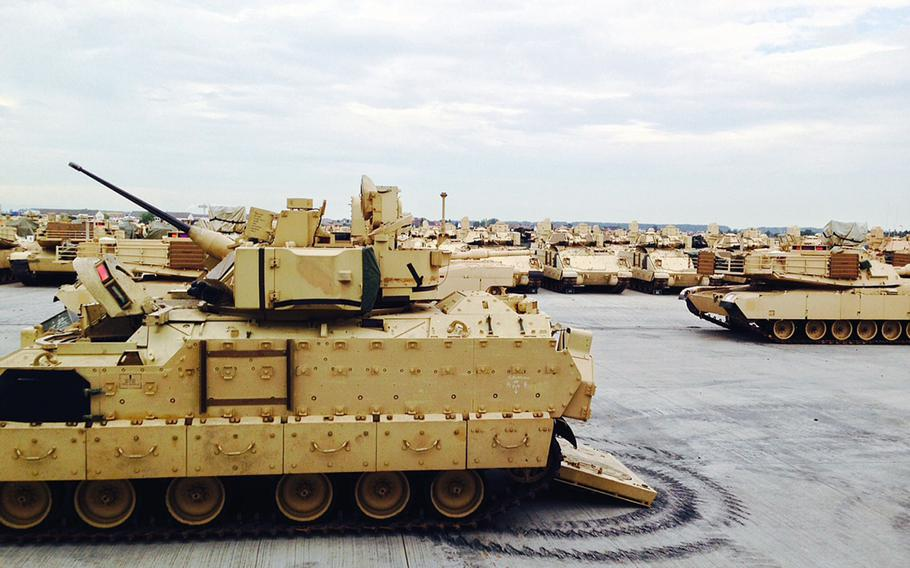 U.S. Army armored vehicles sit at Coleman Barracks in Mannheim, Germany, Tuesday, Sept. 1, 2015. They are part of the European activity set, which supports rotating U.S. forces in Europe.