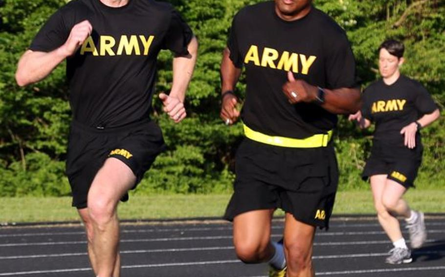Sgt. Maj. of the Army Dan Dailey, left, conducts physical training with soldiers at Redstone Arsenal, Ala. in May 2015. Dailey, who took the position in January, has said he supports soldiers being able to wear black socks with their physical fitness uniforms. Current Army regulations state soldiers must wear plain white socks of at least ankle length.