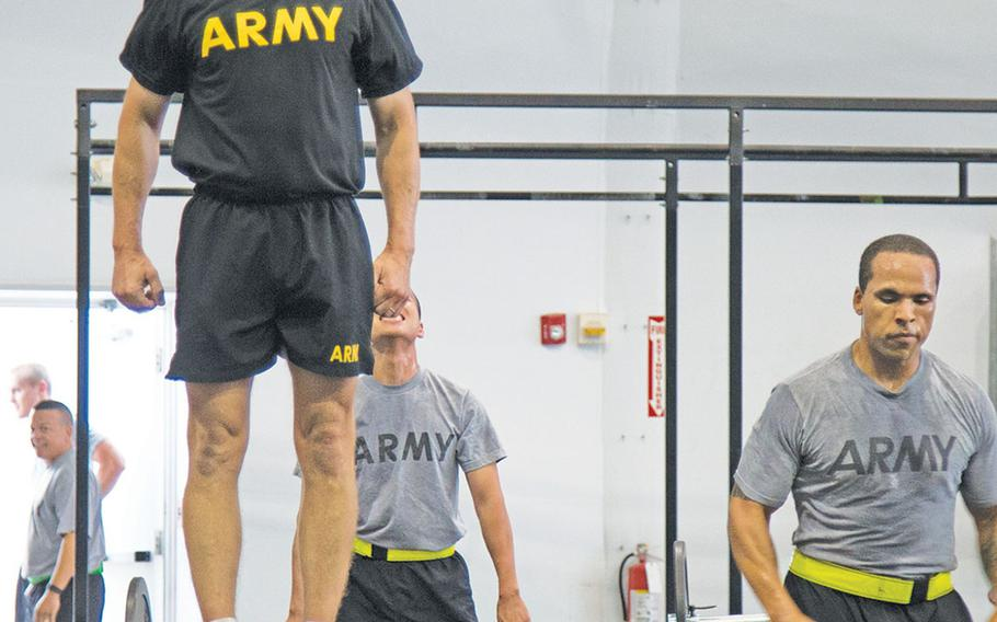 Sgt. Maj. of the Army Dan Dailey does physical fitness with soldiers at Fort Riley, Kan., during a visit there in early July 2015. With the transition to the new black Army Physical Fitness Uniform, which Dailey is wearing here, the SMA has said he supports giving troops the option of wearing black socks if surveys show most troops like the idea.