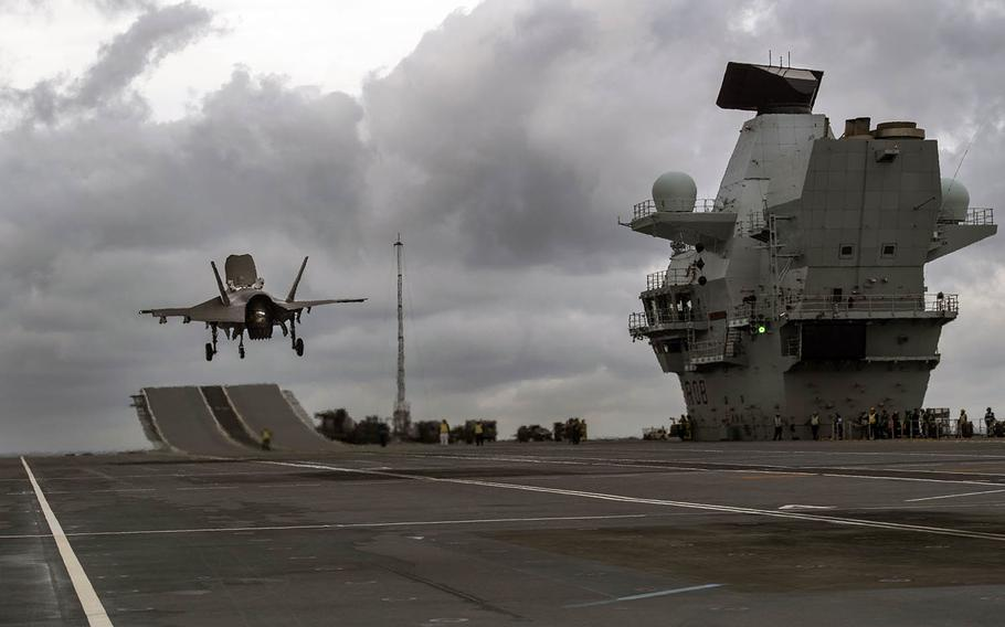 A U.S. F-35 fighter hovers over the HMS Queen Elizabeth on Nov. 3, 2018, during integration trials aboard the carrier.