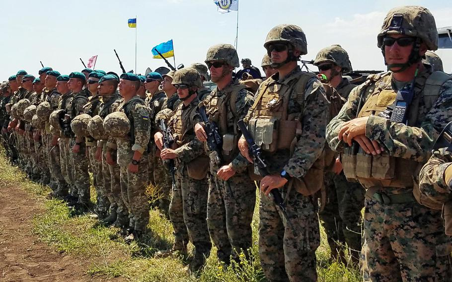 Marines from the U.S. and Ukraine standing together after a company-level attack during the land portion of Exercise Sea Breeze, Saturday, July 14, 2018. Secretary of State Mike Pompeo said NATO allies could take additional steps when allies convene next week to help Ukraine defend against Russia.