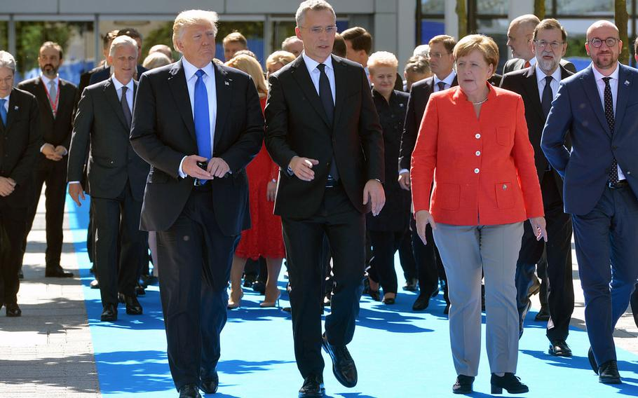 President Donald Trump, NATO Secretary-General Jens Stoltenberg and German Chancellor Angela Merkel walk with other leaders during a NATO meeting in Brussels, Belgium, May 25, 2017. Observers say a chief concern as NATO turns 70 is that the source of tension is mainly coming from the alliance's two most important member states: the U.S. and Germany.