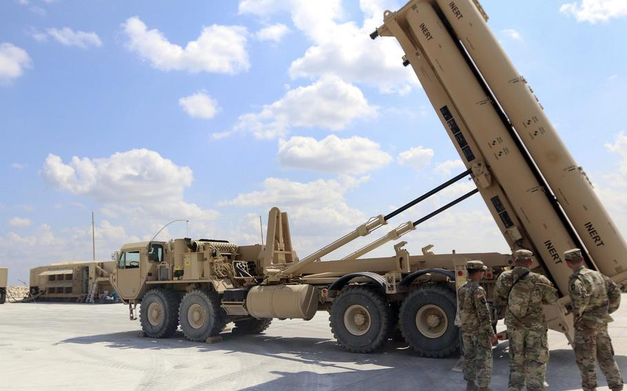 Soldiers with the 69th Air Defense Artillery Brigade look at a Terminal High Altitude Area Defense weapon system at Fort Hood, Texas. The unit will send a THAAD system to Romania this summer.