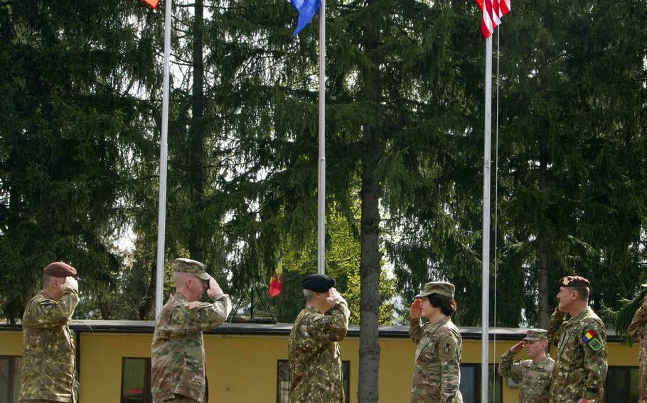 U.S. Army and Romanian leaders salute one another during the opening ceremony of Resolute Castle 2019 at Cincu Joint National Training Center, Romania, April 24, 2019. National Guard units from across the U.S. this week began the long process of building up Polish and Romanian training facilities in Cincu and the Drawsko Pomorskie and Zagan Training Areas in Poland as part of the exercise.