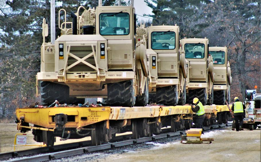 Military vehicles and equipment of the 389th Engineer Battalion is loaded on railcars Feb. 5, 2019, at the rail yard at Fort McCoy, Wis. The movement was for the 389th's future involvement in Operation Resolute Castle 2019 in Poland.
